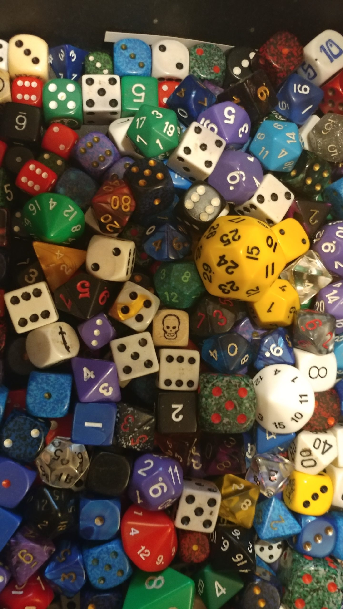 A large and varied pile of dice.